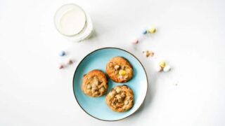Blue Plate of Cadbury Mini Egg Chocolate Chip Cookies for Easter with a glass of milk