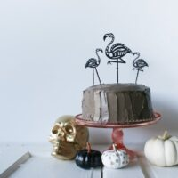 Use your Cricut to cut out these Skeleton Flamingo Cake Toppers for your Halloween party! // Salty Canary