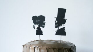 Use your Cricut to cut out these Skeleton Silhouette Cake Toppers for your Halloween party! // Salty Canary