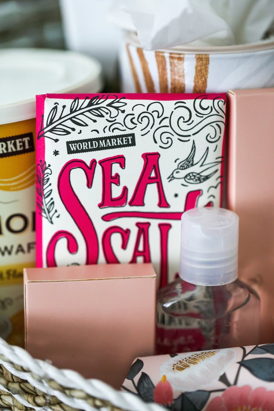 A houseguest welcome basket loaded with essentials and nonessentials to make holiday or overnight guests feel at home in the guest bedroom // Salty Canary