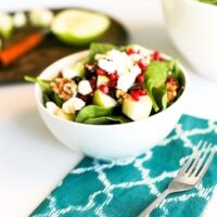 Winter Spinach Salad Recipe with Apples, Dried Cranberries, Pomegranate Seeds, Walnuts, and Feta Cheese