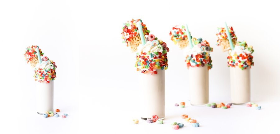 Splurge for breakfast or dessert with this cereal milk milkshake made with cereal-soaked milk, rice krispies treats, and a lot of marshmallow fluff! // Salty Canary