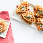 Savory Chicken and Waffle Sliders, perfect for a homemade Sunday brunch. The waffles are a bit spicy to give the sliders a little kick!