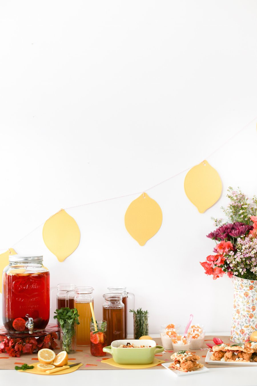 Throw a Southern-Style Spring Brunch Party to celebrate the arrival of spring complete with an Iced Tea Bar, Chicken & Waffle Sliders, and Peach Coconut Grits! The perfect backdrop for Easter, Mother's Day, a spring bridal or baby shower!