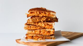Mac And Cheese Grilled Cheese Sandwich // This is one comfort food stuffed into another comfort food and then grilled to perfection! // saltycanary.com