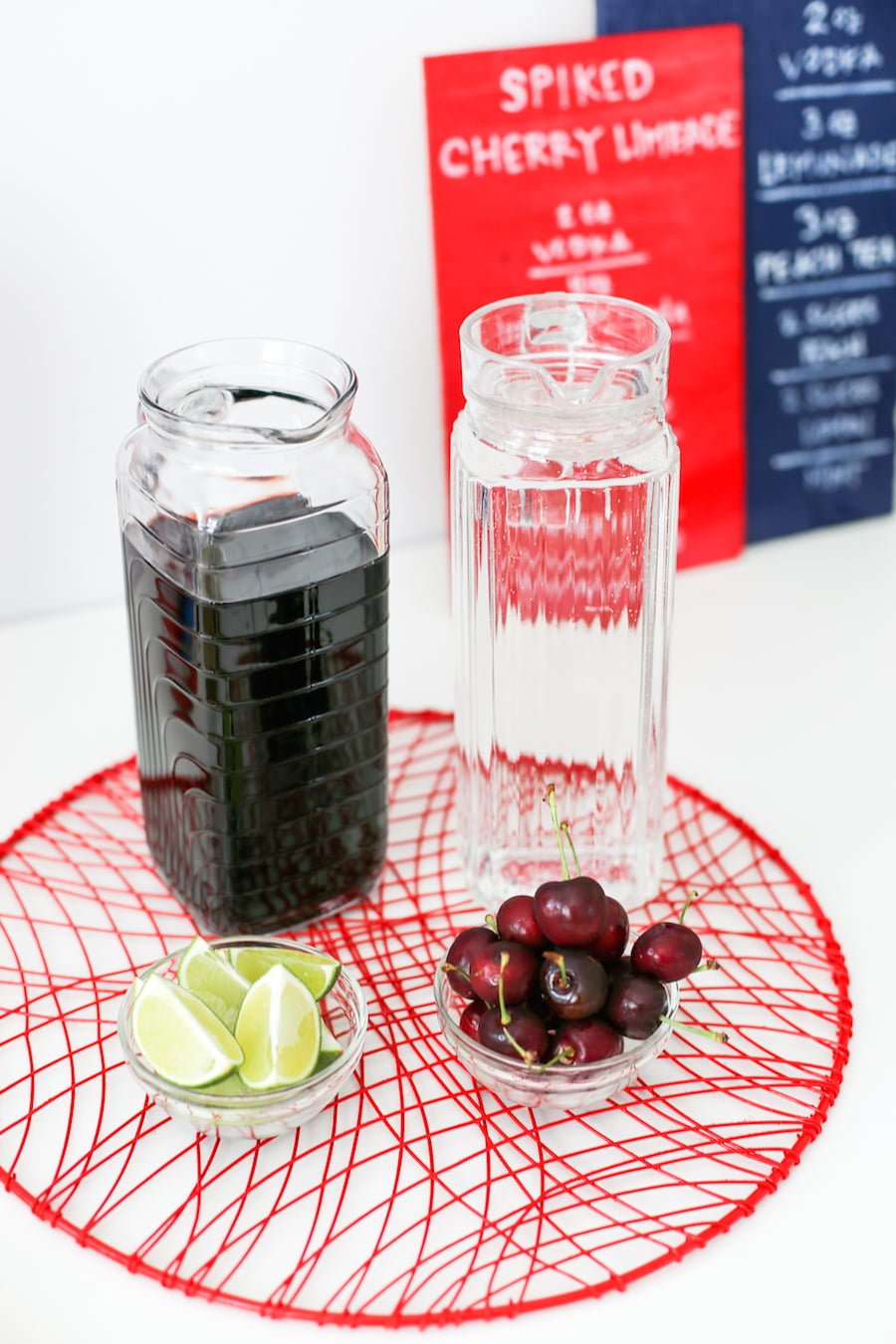 Throw a party with spiked cocktails for this summer's holiday! Cocktails can be a Spiked Cherry Limeade or Spiked Southern Peach Tea! // saltycanary.com
