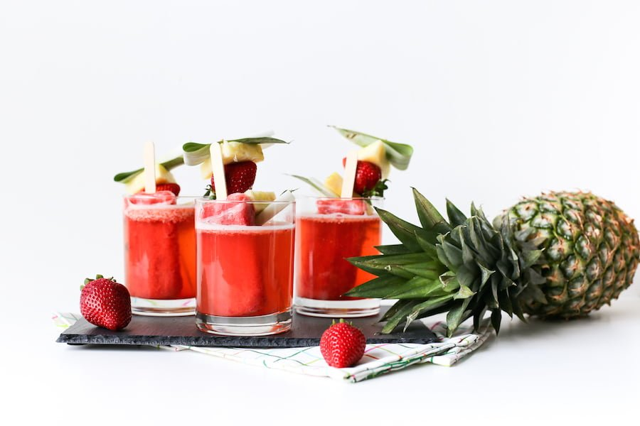 These Tropical Popsicle Mocktails might be my go-to summer treat! They are so good and they are perfect for serving at a party whether it's a pool party, tiki party, or just on a hot Saturday afternoon! // saltycanary.com