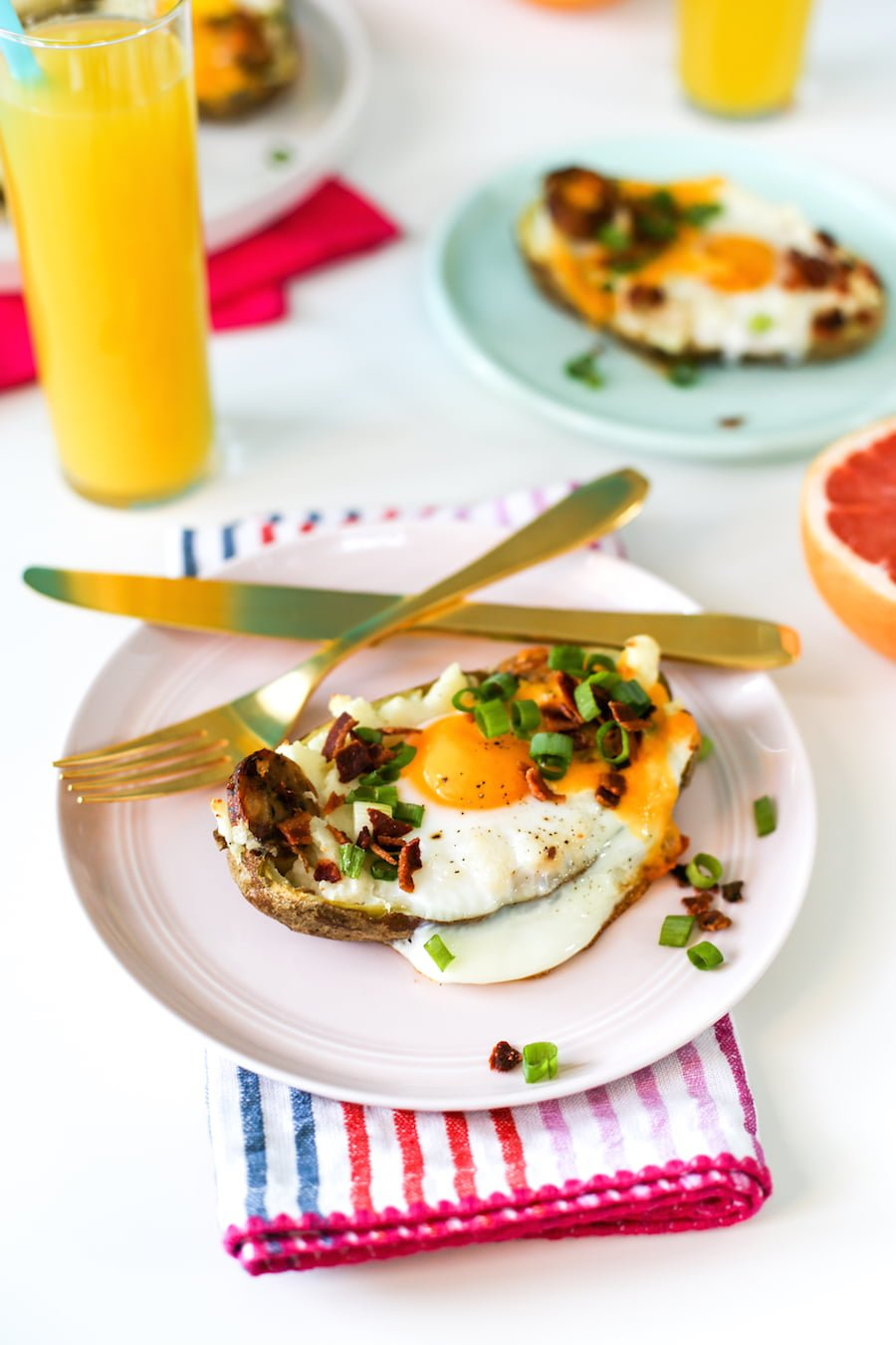Try making these twice baked breakfast potatoes filled with chicken sausage and topped with an egg, bacon, green onions, and cheese! It is sure to be a hit at your next brunch! | saltycanary.com