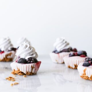 Since they're made in a cupcake pan, that makes them cupcakes right? No frosting, just add some blueberry whipped cream on top of these Yogurt Parfait Cupcakes! | saltycanary.com