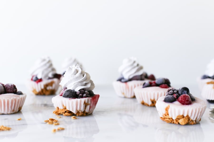 Since they're made in a cupcake pan, that makes them cupcakes right? No frosting, but add some blueberry whipped cream on top of these Yogurt Parfait Cupcakes! | saltycanary.com