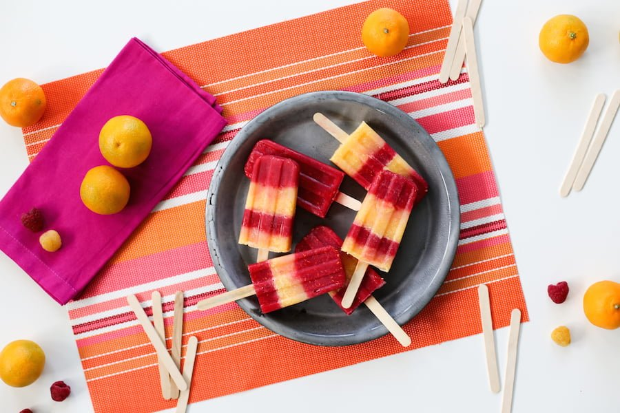 Cool off this summer with these Raspberry Tangerine Popsicles made with Emergen-C! // saltycanary.com