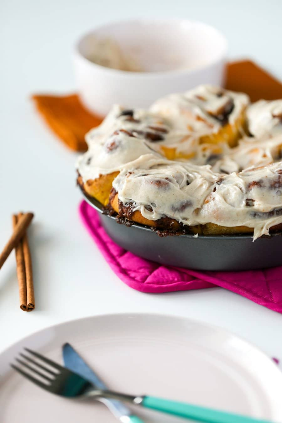 Pan of frosted Pumpkin Spice Cinnamon Rolls