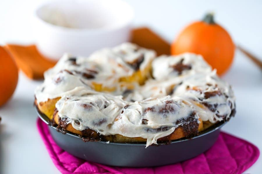 Pumpkin Spice Cinnamon Rolls frosted with a Cinnamon Cream Cheese Frosting
