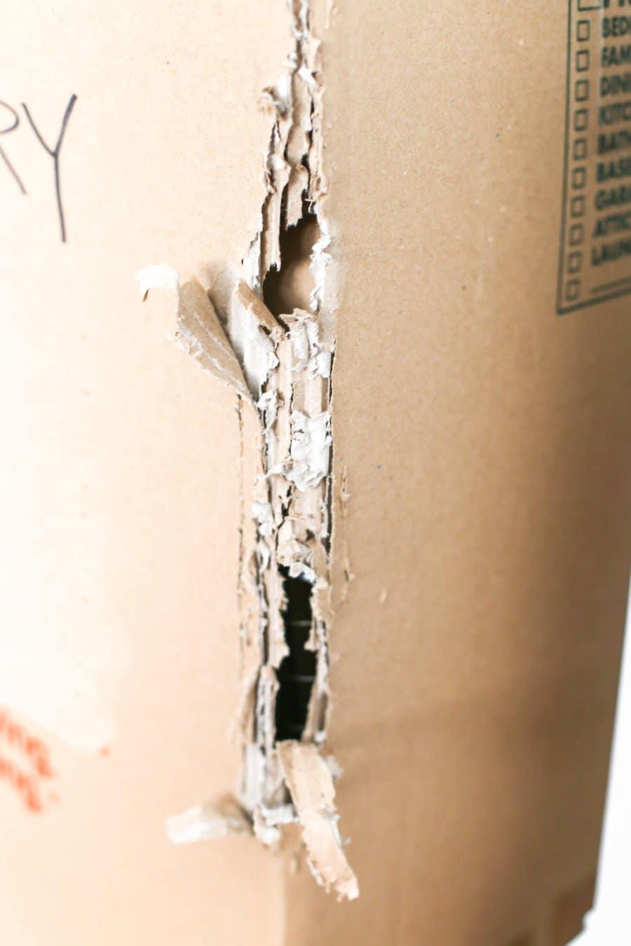 Diy cardboard cat scratcher salty canary for Diy cat tower cardboard