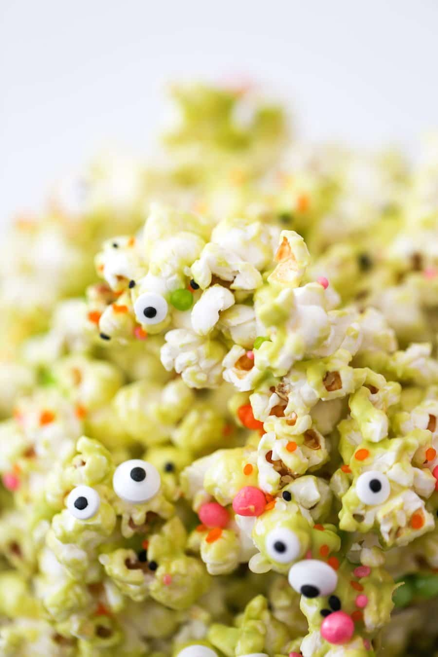 Halloween Monster Popcorn, Monster Munch Popcorn, Halloween party popcorn, candied popcorn, green popcorn, eyeballs, gooey popcorn, Salty Canary