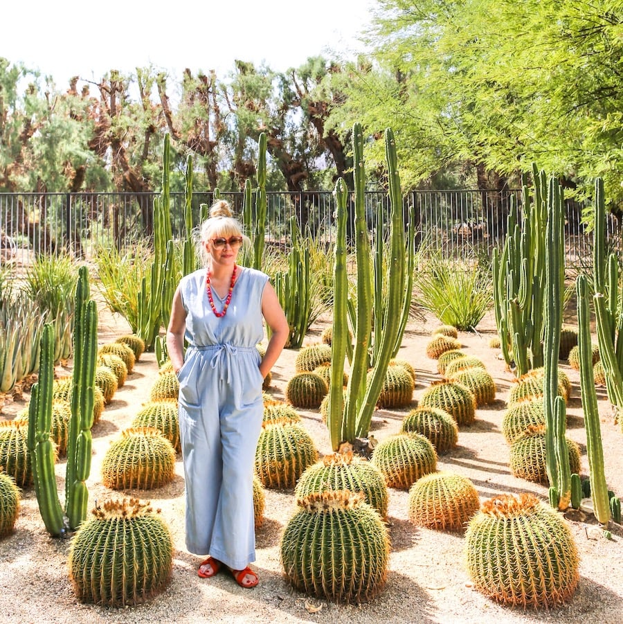 Woman standing in cactus garden at Sunnylands near Palm Springs