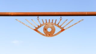 Metal Eye Gate at entrance to El Cosmico in Marfa, Texas