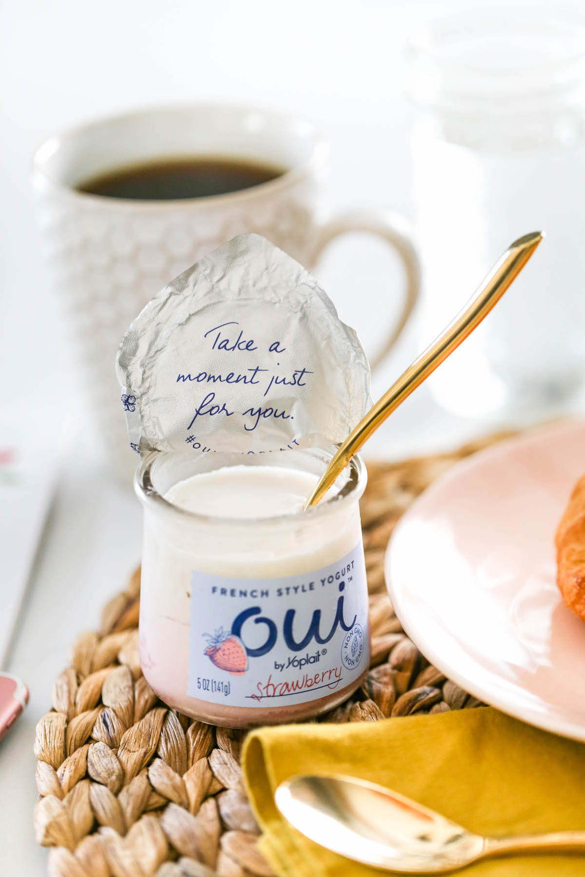 """Open bottle of yogurt. The lid has """"Take a moment just for yourself"""" written on it."""